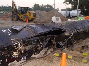 Ruptured pipeline in Michigan that spilled 20,000 barrels of light crude into the Kalamazoo River. The clean up cost over $1 billion. (Photo from vice.com)