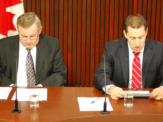 Environment Minister Jim Bradley and Natural Resources Minister David Orazietti speak at Queen's Park. (Photo by Andrew Reeves)
