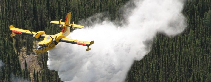 A CL-415 heavy water bomber fights forest fires in Northern Ontario.