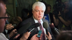 NDP MPP Peter Tabuns speaking with reporters at Queen's Park. (CBC News Image.)